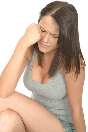 miserable: Portrait of a Sad Unhappy Attractive Young Woman in Her Twenties in Distress and Worried Stock Photo