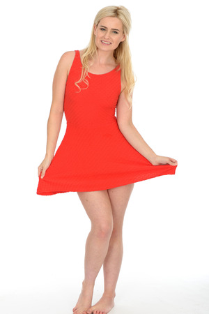 bare feet girl: Attractive Sexy Young Blonde Haired Woman in Her Twenties Wearing a Short Red Mini Dress in Bare Feet Stock Photo