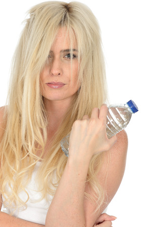 the twenties: Fit Healthy Sexy Young Blonde Woman in Her Twenties Holding a Bottle of Mineral Water
