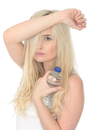 bothered: Fit Healthy Sexy Young Blonde Woman in Her Twenties Holding a Bottle of Mineral Water