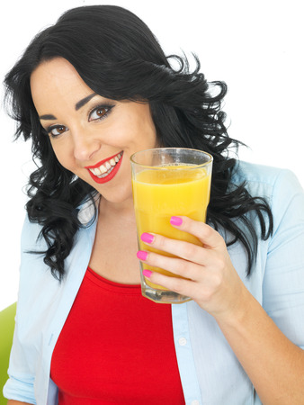 elevenses: Young Healthy Woman Drinking Fresh Orange Juice