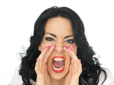 temper: Portrait of an Angry Frustrated Young Hispanic Woman in Her Twenties Shouting in Temper Stock Photo