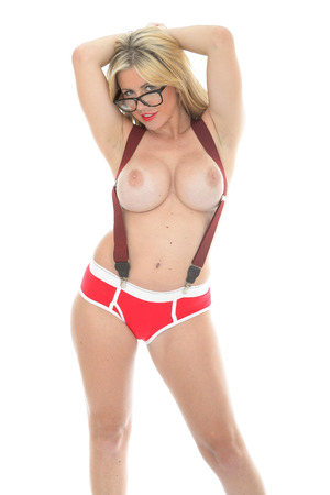 erotic fantasy: Beautiful Sexy Young Topless Woman In Pin Up Poses Wearing Braces Glasses and Red Pants Against White