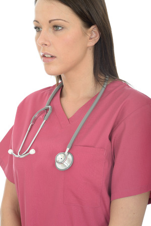 unifrom: Portrait Of A Young Beautiful Female Doctor In Her Twenties Wearing Pink Theatre Scrubs Looking Serious Stock Photo