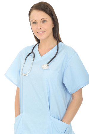 Portrait Of A Beautiful Young Female Doctor Confident and Relaxed Wearing BLue Theatre Scrubs And A Stethoscope photo