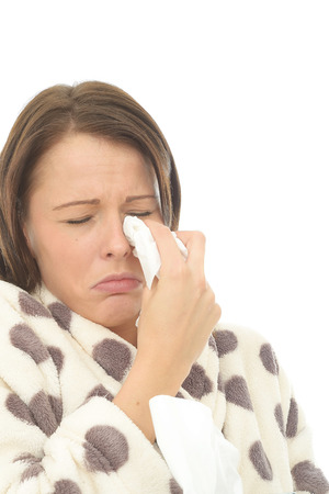 tearful: Distressed Depressed Young Woman Crying And Wiping Away Tears With A Paper Tissue