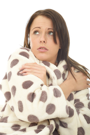 cosy: Frightened Scared Attractive Young Woman Against A White Background Wearing A Warm Cosy Dressing Gown
