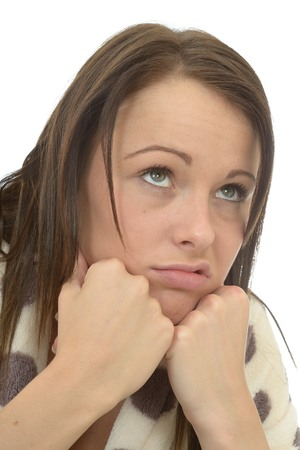 miserable: Close Up Head Shot Of A Miserable Bored Depressed Young Woman Resting Her Head On Her Hands