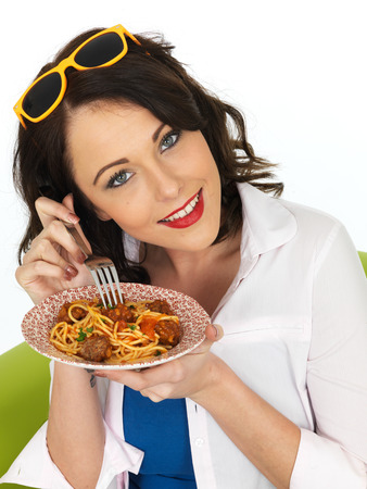 Beautiful Attractive Young Woman in Her Twenties Holding a Plate of Spaghetti and Meatballs photo