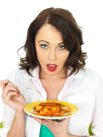 filled out: Pretty Attractive Young in Her Twenties Woman Holding and Eating a Plate of Ravioli Pasta