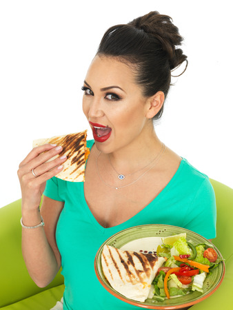 low cut: Beautiful Attractive Young Hispanic Woman Holding A Plate Of Mexican Quesadula With Salad
