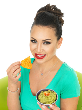 low cut: Beautiful Young Hispanic Woman In Her Twenties Holding A Small Bowl Of Homemade Guacamole