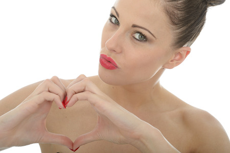 a situation alone: Attractive Young Woman Making A Heart Sign or Shape With Her Hands Looking At The Camera Shot Against White Stock Photo