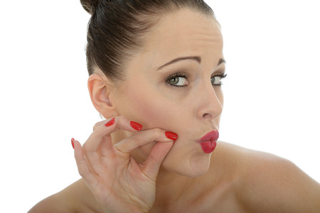 a situation alone: Beautiful Young Woman Blowing Kisses Looking At The Camera Shot Against White