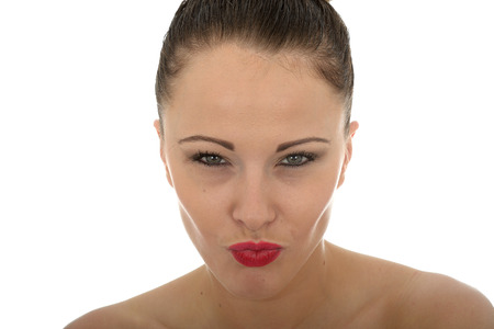 stern: Portrait Of A Very Stern Evil Looking Beautiful Young Caucasian Woman With Her Lips Pursed In A Tense Pose Against White Stock Photo