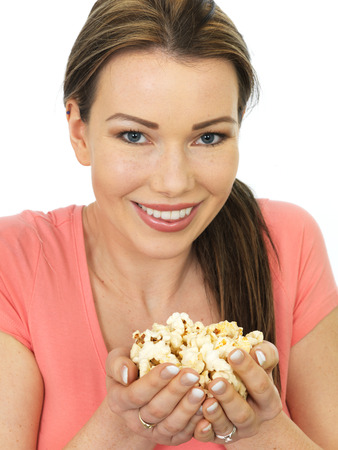 handful: Attractive Happy Smiling Young woman Holding A Handful Of Popcorn