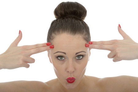 make believe: Portrait Of A Beautiful Young Woman With Her Fingers Against Her Forehead As Make Believe Guns Stock Photo