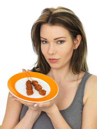 party with food: Attractive Young Woman Holding a Plate of Chicken Satay Kebab Party Food