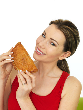 pasty: Attractive Young Woman Holding a Cooked Cornish Pasty Savory Snack