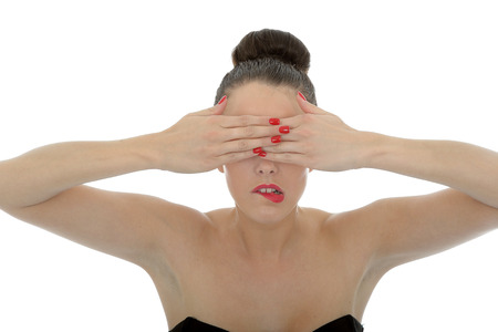 hands covering eyes: Portrait Of A Beautiful Attractive Young Woman Covering Her Eyes With Her Hands Shot Against A White Background