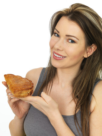 pasty: Attractive Happy Young Woman Holding a Baked Cornish Pasty