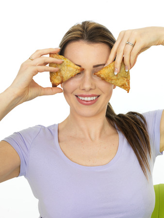 messing: Attractive Happy Young Woman Holding Spicy Vegetarian Samosa Savory Snacks