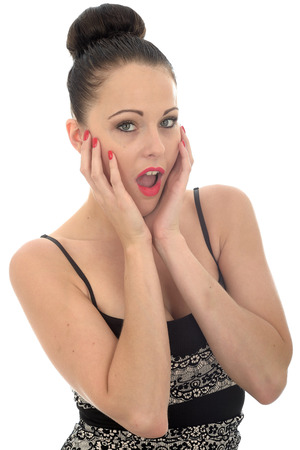 mouthed: Beautiful Attracitve Young Caucasian Woman Holding Her Head In Her Hand Looking Shocked and Surprised Against White Stock Photo