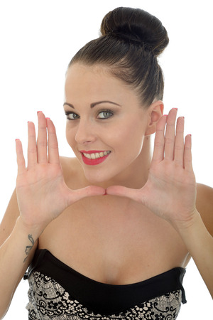 a situation alone: Beautiful Young Woman Framing Her Face With Her Hands Looking Happy and Pleased Smiling Shot Against A White Background