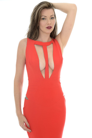 sex appeal: Beautiful Sexy Young Woman Wearing a Revealing Seductive Red Dress Stock Photo