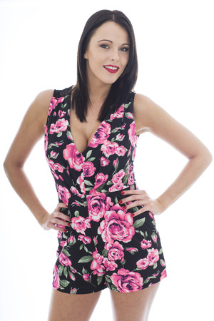 cleavage: Attractive Sexy Young Woman Wearing a Short Floral Playsuit Shot Against A White Background Showing Cleavage