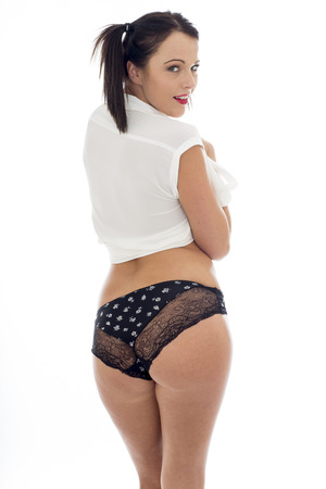 Attractive Sexy Young Model Wearing An Open White Shirt And Black Panties With Hair Bunches