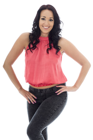 mid twenties: Sexy Attractive Young Hispanic Woman Posing In A Casual Trendy Pink Top and Black Jeans Against A White Background Stock Photo
