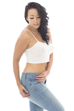 pin up model: Attractive Young Hispanic Pin Up Model Wearing Blue Jeans and a Crop Top Stock Photo