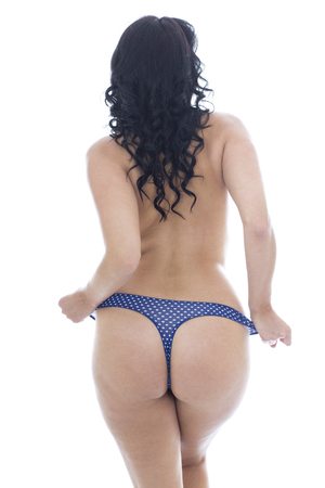 semi nude: Sexy Young Hispanic Woman Posing Classical Pin Up Topless Glamor Wearing Blue Lingerie Panties Against A White Background