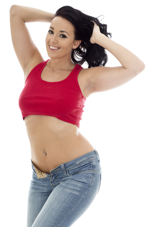 undone: Attractive Young Sexy Sensual Hispanic Woman Posing Pin Up In Jeans and a Red Top Against A Plain White Background