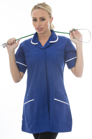 matron: Attractive Young Woman Posing As A Doctor or Nurse In Theatre Scrubs With A Stethoscope Isolated against a Plain White Background Stock Photo