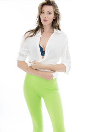 legging: Sexy Young Woman Wearing Green Legging In PIn Up Poses Looking Sensual and Flirting Isolated Against A White Background