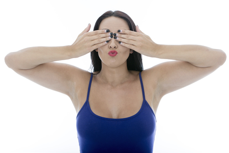 daft: Attractive Young Woman Covering Her Eyes Pulling Faces Isolated Against a White Background