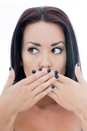 mouth close up: Close Up Portrait of an Attractive Young Woman Covering Her Mouth With Her Hands Isolated Against a Plain White Background