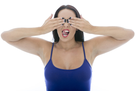 low cut: Attractive Young Woman Covering Her Eyes Pulling Faces Isolated Against a White Background