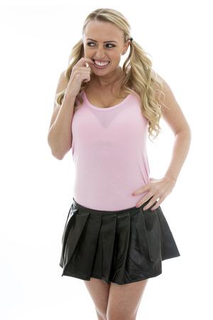 mini falda: Atractiva feliz emocionada acertada mujer joven con un cuero Negro mini falda y tapa del tanque de la pinta Foto de archivo