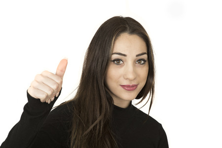 over black: Attractive Confident Young Woman Giving Positive Thumbs Up Gesture Stock Photo