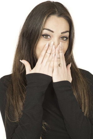 aghast: Attractive Shocked Surprised Young Woman Covering Her Mouth With Her Hands