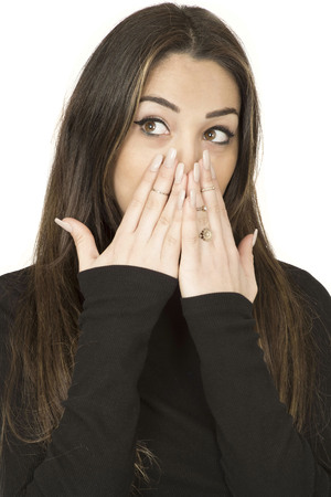 unplanned: Attractive Shocked Surprised Young Woman Covering Her Mouth With Her Hands