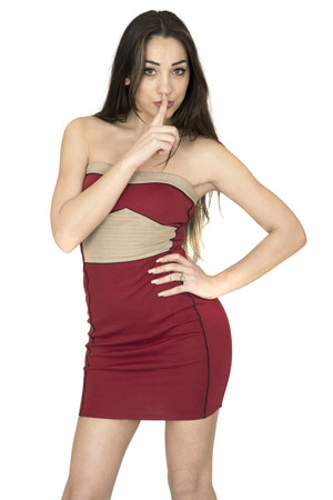 mini dress: Sexy Attractive Young Woman Wearing Red Mini Dress Keeping A Secret Against A White Background