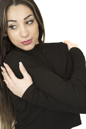 over black: Portrait of a Relaxed Confident Sexy Young Woman Wearing a Black Roll Neck Jumper