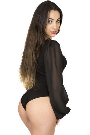turnanzug: Schöne gesunde Fit junge Frau posiert in einem schwarzen Leotard Dessous-Set vor einem weißen Hintergrund
