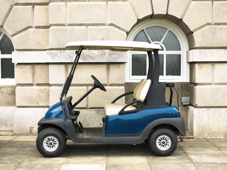 Blue Golf Buggy Parked Outside Against A Georgian Style Stone ... Curved Golf Cart on golf players, golf accessories, golf buggy, golf girls, golf tools, golf machine, golf hitting nets, golf card, golf words, golf games, golf trolley, golf handicap, golf cartoons,