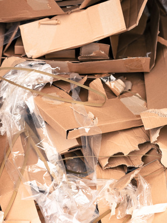 dumped: Pile or Stack of Empty Cardboard Boxed and Plastic Wrapping Material Dumped in a Heap of Waste Stock Photo