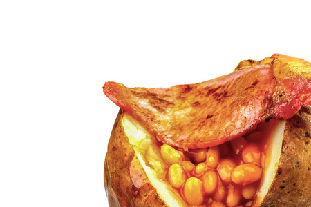jacket potato: Creative Image of a Baked or Jacket Potato Isolated Against a White Background With Copy Space